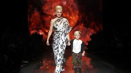 Designer Gwen Stefani walks the runway with her