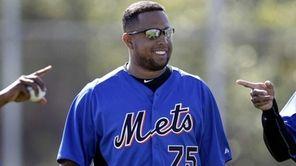 Mets pitcher Francisco Rodriguez walks between two teammates