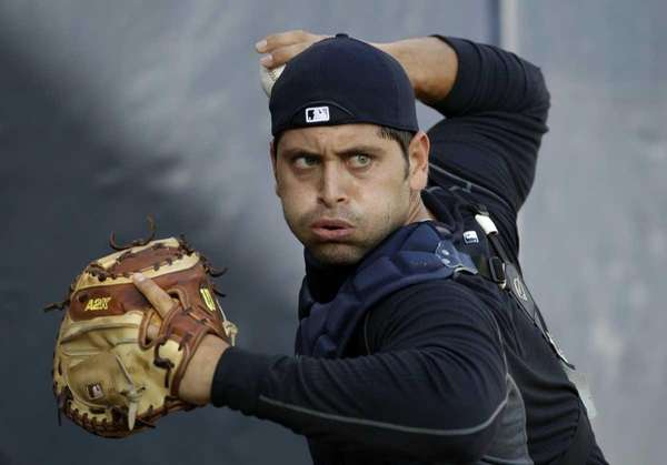 Yankees catcher Francisco Cervelli works on a throwing