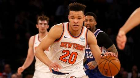 Knicks guard Kevin Knox controls the ball in