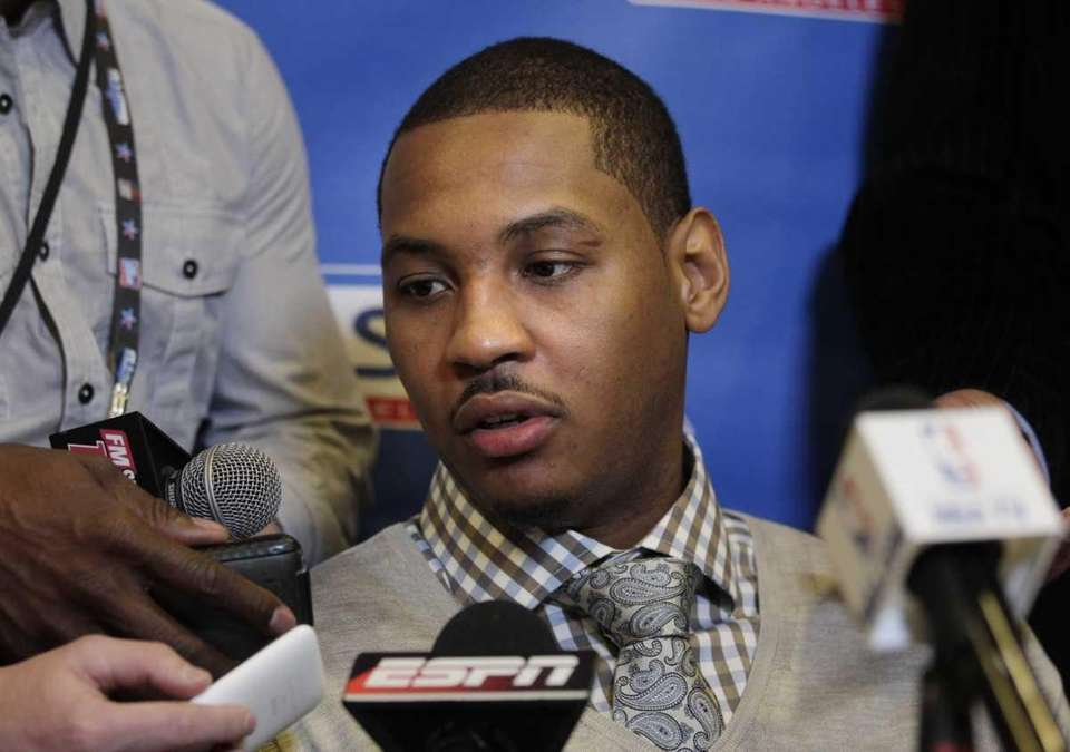 Denver Nuggets' Carmelo Anthony talks to reporters during