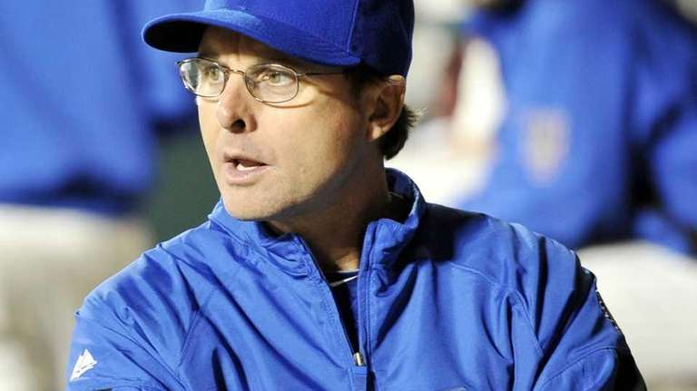 Tim Teufel looks from the dugout before the