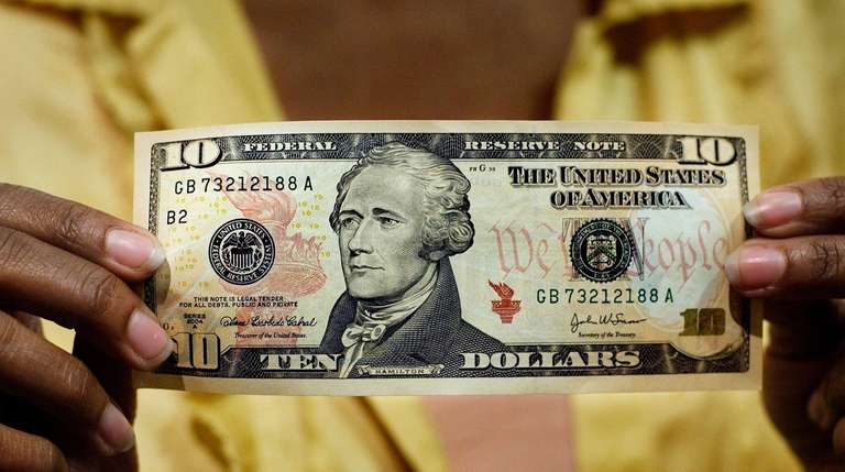 A $10 bill is displayed at the National