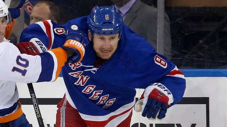 The Rangers' Cody McLeod battles for the puck