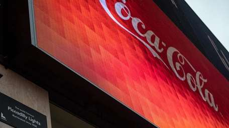 The soft drink giant reports quarterly earnings this
