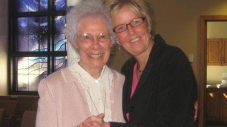 Sister Joan Kellenberg, left, with Ann Amideo.