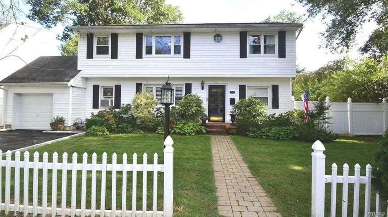 This Huntington Station Colonial, with five bedrooms and
