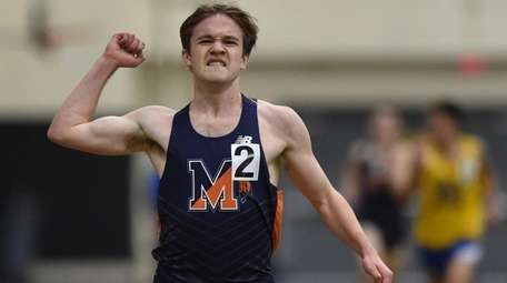 Christopher Courts of Manhasset reacts after winning the