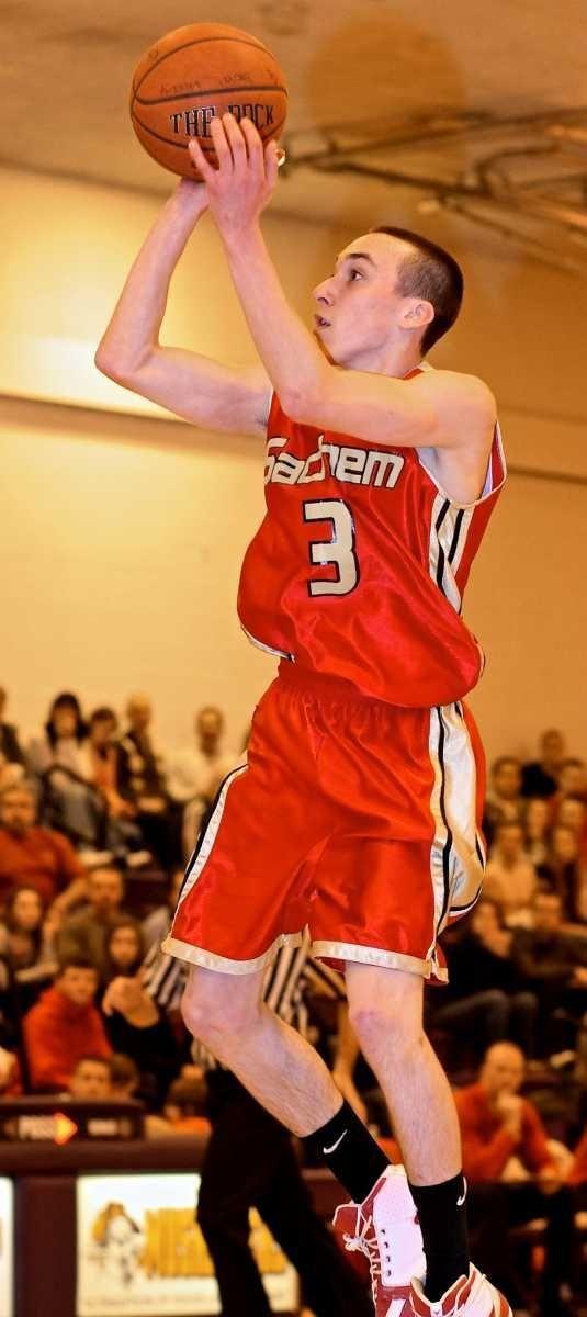 Sachem East guard Alec Daniello #3 puts up