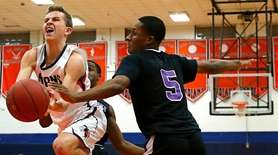 Chris Themelis of Manhasset drives against Spardley Jean-Baptiste