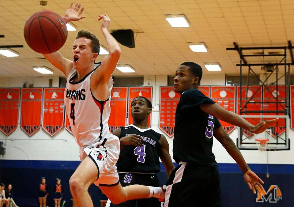 Chris Themelis #4 of Manhasset attempts a dunk