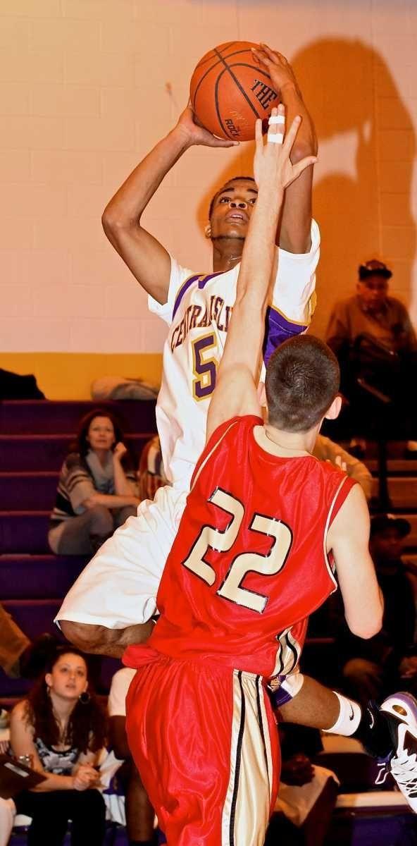 Central Islip guard Derrick Franklin #5 puts up