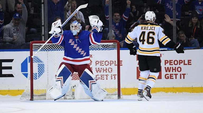 Rangers goaltender Alexandar Georgiev reacts after making a