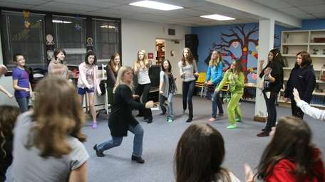Kathy Lahey, a certified self-defense instructor, teaches girls