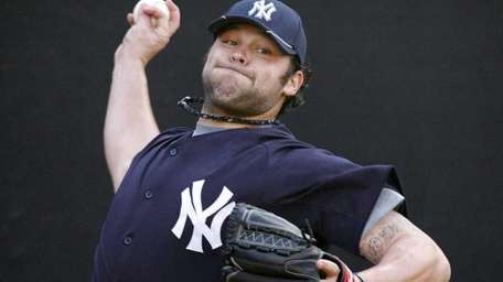 New York Yankees pitcher Joba Chamberlain throws during