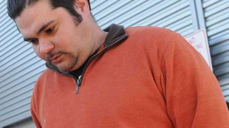 Pablo Lopez, 34, of Central Islip, is led