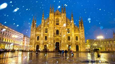Milan's Duomo Cathedral is bathed in artificial lights