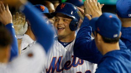 Mets catcher Devin Mesoraco celebrates his pinch-hit three-run