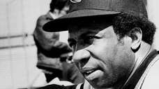 Frank Robinson, MLB's first black manager, watches his