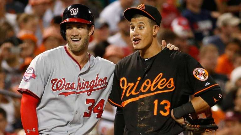 Free agents Bryce Harper, left, and Manny Machado