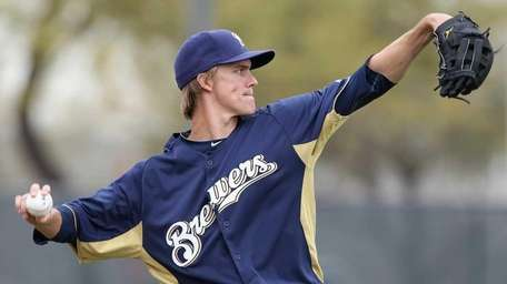 ZACK GREINKE, Starting pitcher Traded to the Brewers