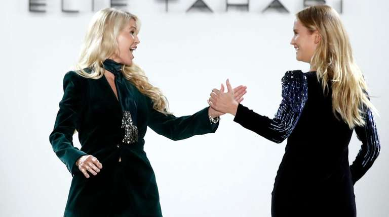 Christie Brinkley high-fives her daughter Sailor Lee Brinkley
