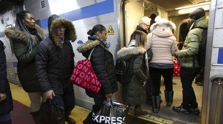 Long Island Rail Road riders board a rush-hour