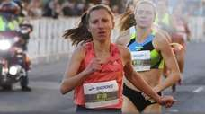 Emily Lipari crosses the finish line as she