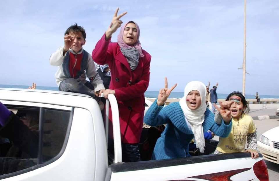 Residents riding in the back of a vehicle