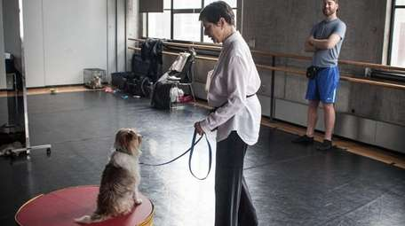 Isabella Rossellini works with her dog, Pan, and