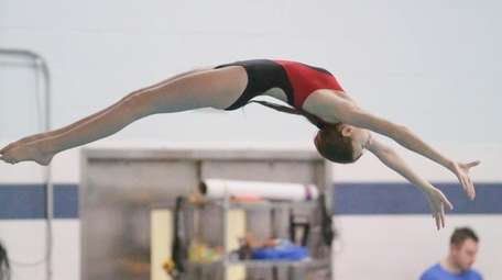 Half Hollow Hills Ashley Brule dives during the