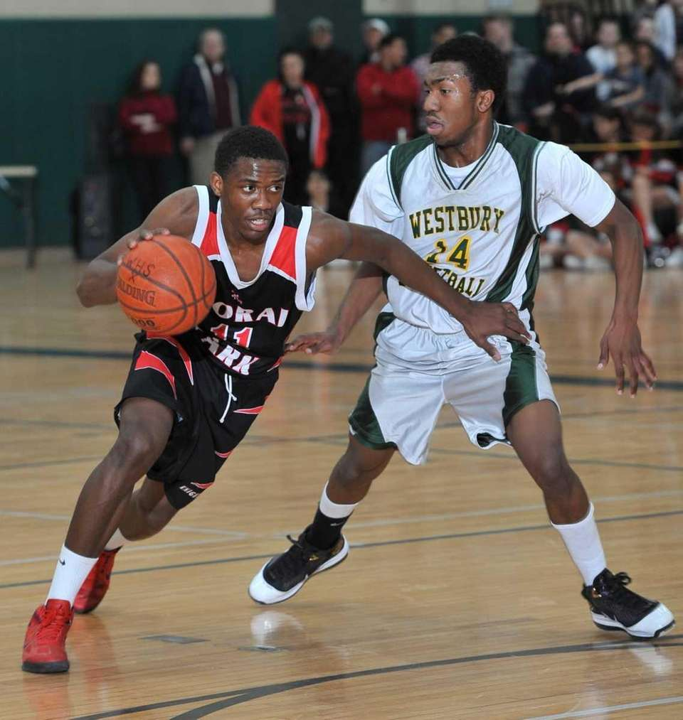 Floral Park's Shamoy McIntosh, left, drives the ball