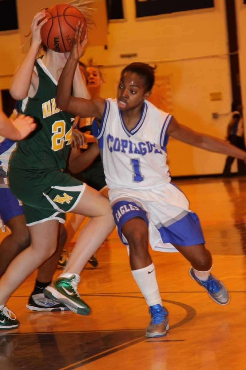 Copiague's Domyae Ivory-Byrd looses possession of the ball