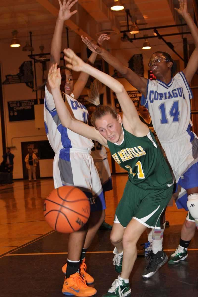 Ward Melville's Caysea Cohen loses the ball under