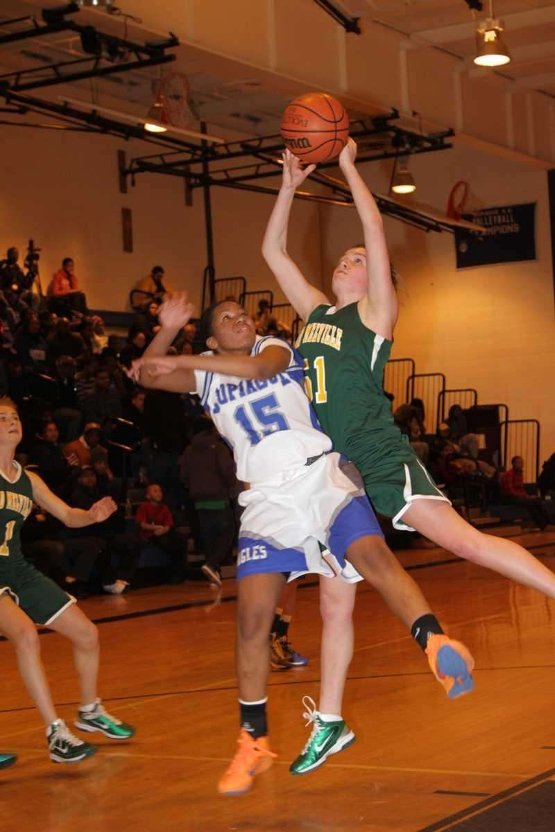 Copiague's Chelsea Williams fights for a rebound with