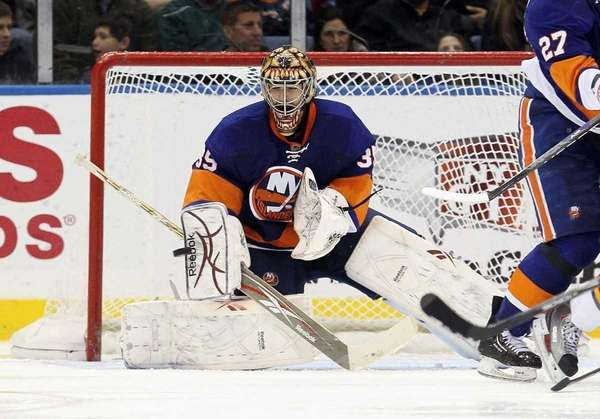 The Islanders' Al Montoya makes a third-period save