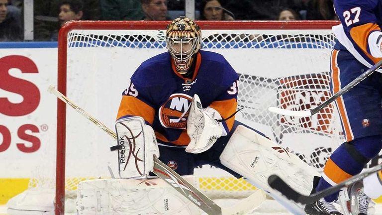 The Islanders' Al Montoya makes a third-period save