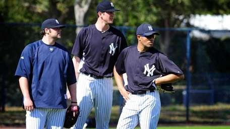 Yankees pitching prospect Andrew Brackman, center, is feeling