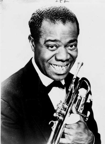 LOUIS ARMSTRONG In 1922, Louis Armstrong revolutionized jazz