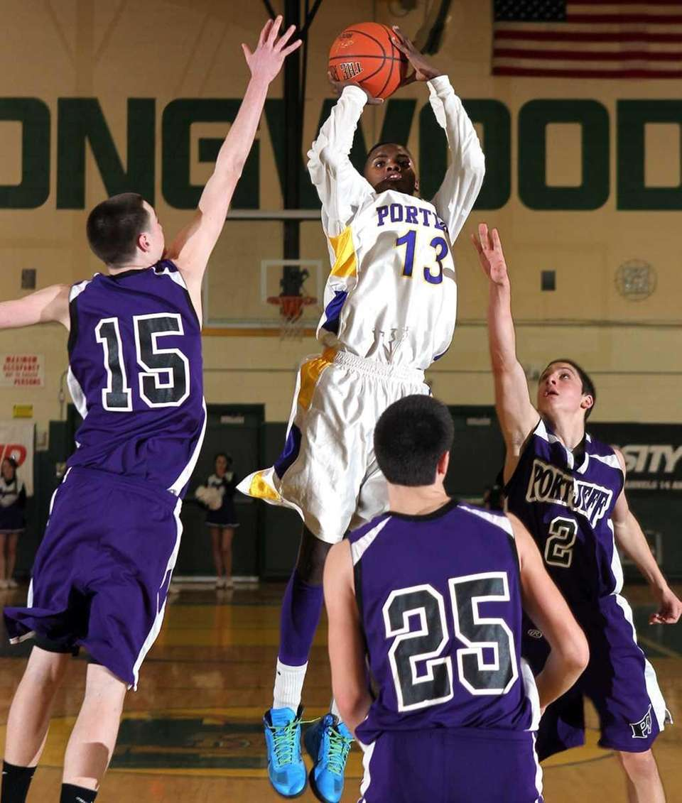 Greenport's Dantre Langhorne (13) goes up for a