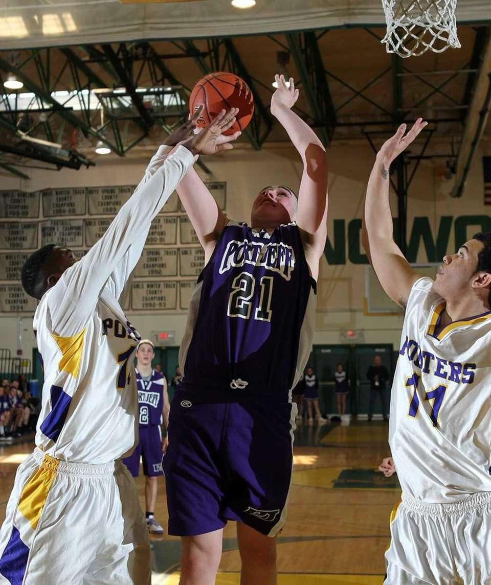 Port Jefferson's Greg Nielsen (21) is fouled by