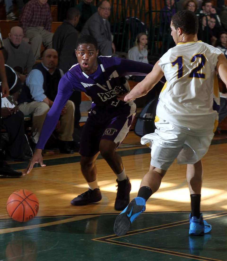 Port Jefferson's Terell Rose drives around Greenport's Tremayne