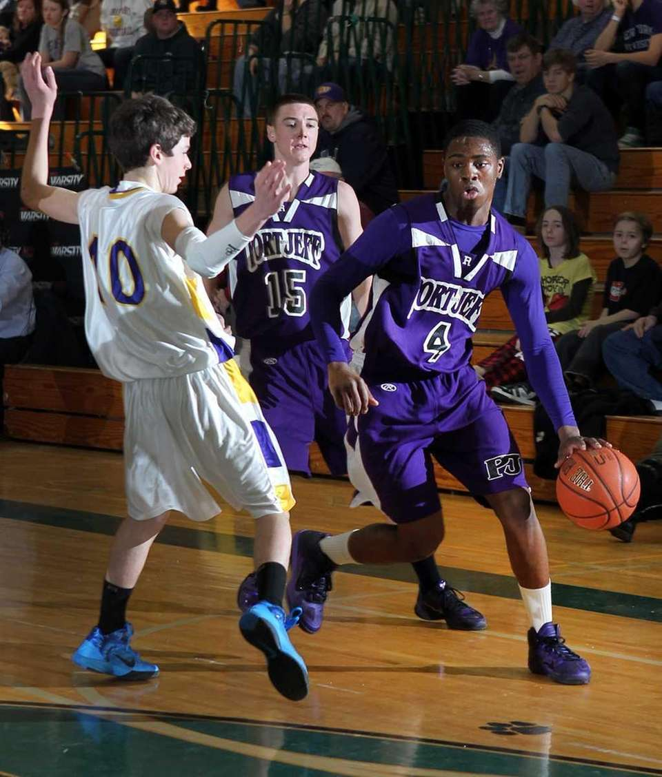 Port Jefferson's Terell Rose drives around Greenport's Sean