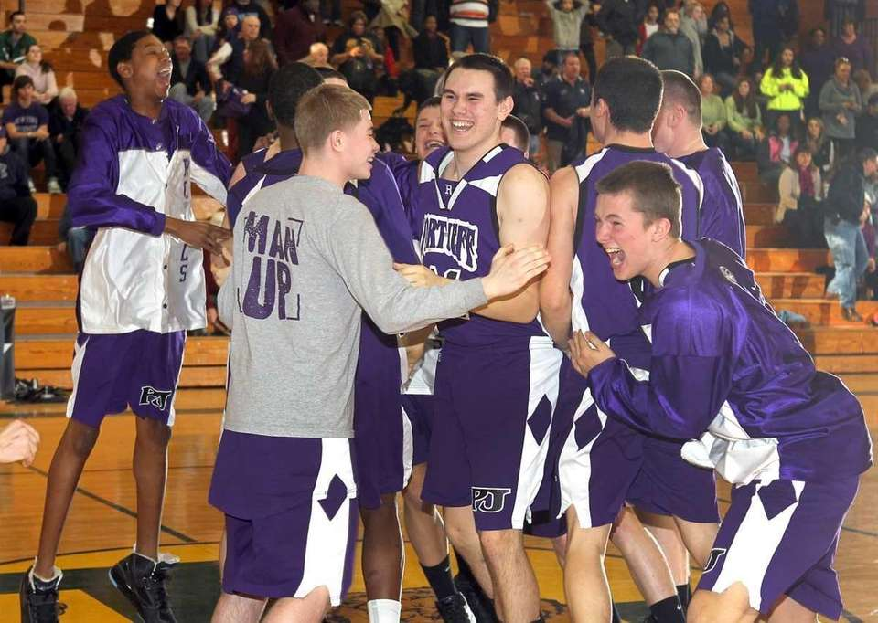 Port Jefferson players celebrates their victory over Greenport