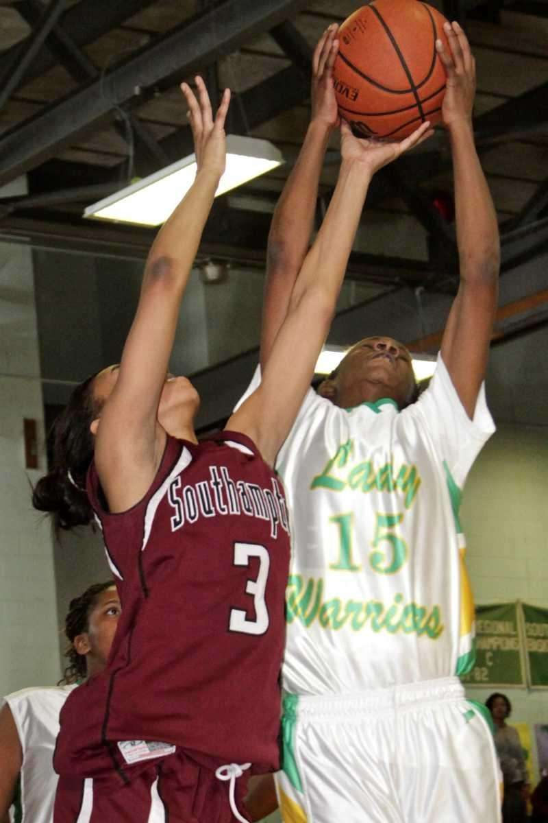 Wyandanch's Lineker St. Hilaire fights for possesion with