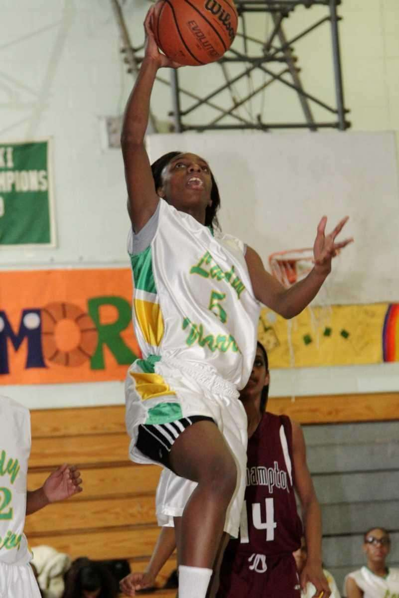Wyandanch's Jalicia Robinson drives to the basket during