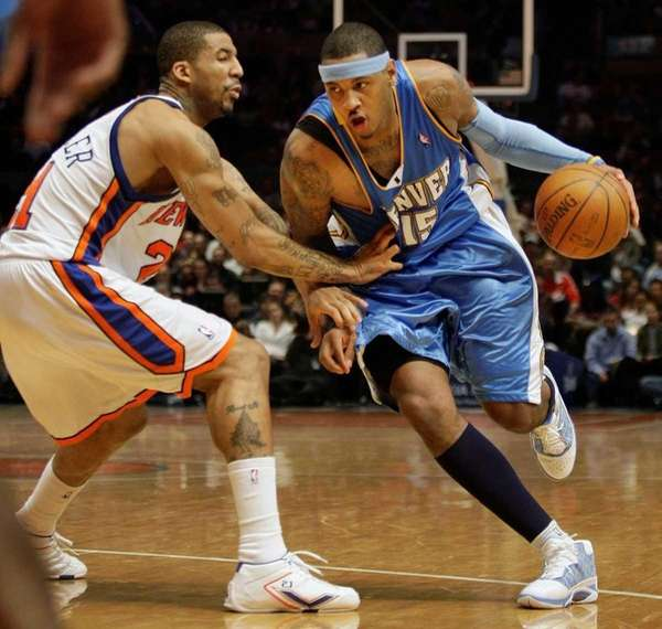 Denver Nuggets forward Carmelo Anthony (15) drives past