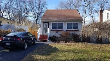 This house in Mastic is on the market
