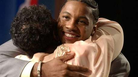 Carmelo Anthony, of Syracuse, gets a hug from