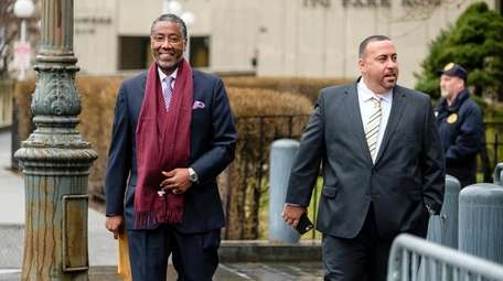 Norman Seabrook, left, arrives at federal court in